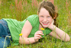 Young girl in spring field Stock Images