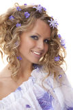 Young girl and  spring flowers in her hair Stock Photo