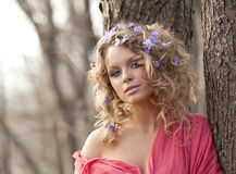 Young girl and  spring flowers in her hair Royalty Free Stock Photography