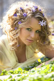 Young girl and  spring flowers in her hair Stock Photography