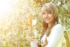 Young girl in a spring garden Stock Photography