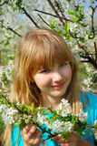 Young girl in spring orchard Stock Photography