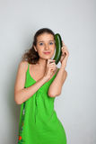 Young girl with squash zucchini Royalty Free Stock Images