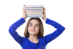 Young girl with stack of books on her head Stock Image
