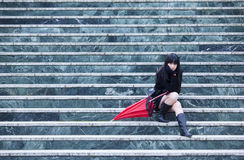 Young girl on stairs Royalty Free Stock Photo