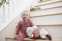 Young Girl On Stairs In Pajamas At Christmas Stock Image