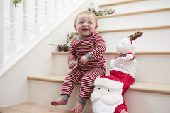Young Girl On Stairs In Pajamas With Toy At Christmas Royalty Free Stock Images