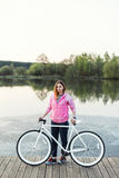 Young girl stand with bicycle Royalty Free Stock Images