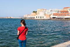 Young girl standing alone on the sea-front stock image
