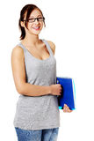 Young girl standing ang holding notebook. Stock Images