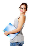 Young girl standing ang holding notebook. Royalty Free Stock Photos