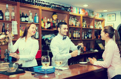 Young girl standing at bar Stock Photography