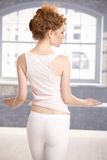 Young girl standing by bar showing her back Royalty Free Stock Photography