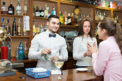 Young girl standing at bar Royalty Free Stock Image