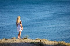 Young girl standing on the beach Stock Photo