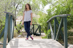 Young girl. Standing on a bridge Stock Photo