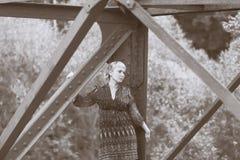 Young girl standing on bridge bearing Stock Photos