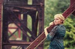 Young girl standing on bridge bearing Royalty Free Stock Image