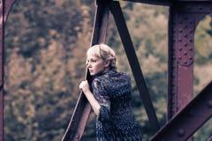 Young girl standing on bridge bearing Stock Photography