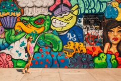 Young Girl Standing By The Colorful Graffiti Wall In Los Angeles Stock Image