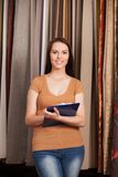 Young girl standing in dry goods store. Royalty Free Stock Photos