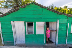 Young girl standing in front of her home, near Cabral in Dominican Republic Royalty Free Stock Photos