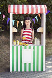 Young girl standing at a fruit stand Stock Photos