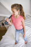 Young Girl Standing On Her Bed Royalty Free Stock Photography