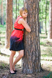 Girl standing near the tree. Young girl standing near the tree in park Royalty Free Stock Photography