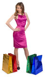 Young girl standing next to a shopping bags Royalty Free Stock Image
