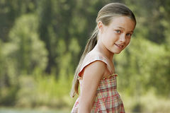 Young Girl Standing Outdoors Stock Photos