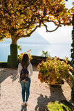 Young girl standing on the pathway in park of Villa Balbianello. In Lenno, Lake Como, Italy royalty free stock images