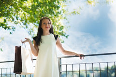 Young girl standing with shopping bag Stock Photos