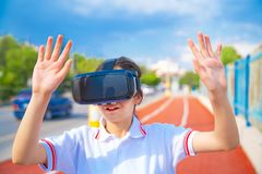 Young girl standing in the street with 3D glasses. royalty free stock photography