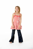 Young Girl Standing In Studio Stock Images