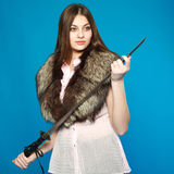 A young girl standing with a sword in his hand Royalty Free Stock Image