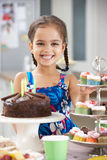 Young Girl Standing By Table Laid With Birthday Party Food Royalty Free Stock Images