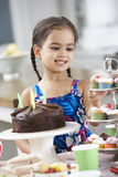 Young Girl Standing By Table Laid With Birthday Party Food Stock Images