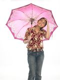 Young girl standing with umbrella Stock Photo