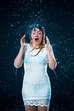 The young girl standing under running water Royalty Free Stock Images
