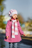 Young girl standing at walkway Royalty Free Stock Photos