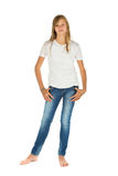 Young girl standing with white t-shirt and blue jeans over white Royalty Free Stock Photo