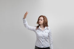 Young girl stands back and working with virtual Royalty Free Stock Images