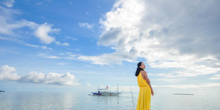 Young girl stands on beach Royalty Free Stock Photo
