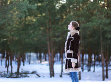 Young girl stands in the forest Royalty Free Stock Photos