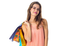 Young girl stands up straight and keeps the shoulder bags isolated on white background Stock Images