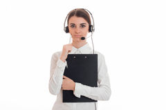 A young girl stands upright holding a Tablet and listening headset Royalty Free Stock Photo