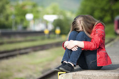 Young girl at the station Stock Photography