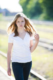 Young girl at the station. Sad girl on train station royalty free stock photography