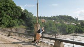 Young girl stay on the bridge - Georgia.  stock footage